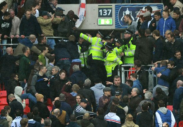 Millwall fans fighting each other and the police in a cup semi-final
