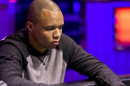 Phil Ivey playing in a live poker tournament, purple and red background