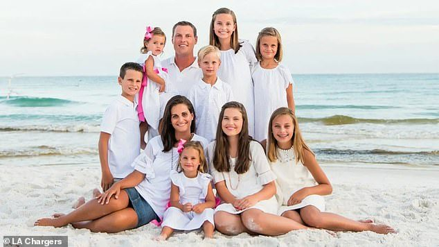 Philip Rivers kids and wife on a beach.