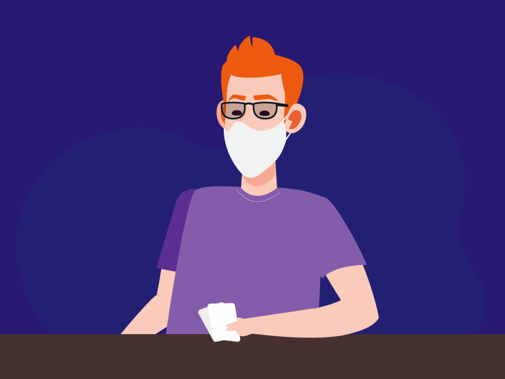person playing poker with mask
