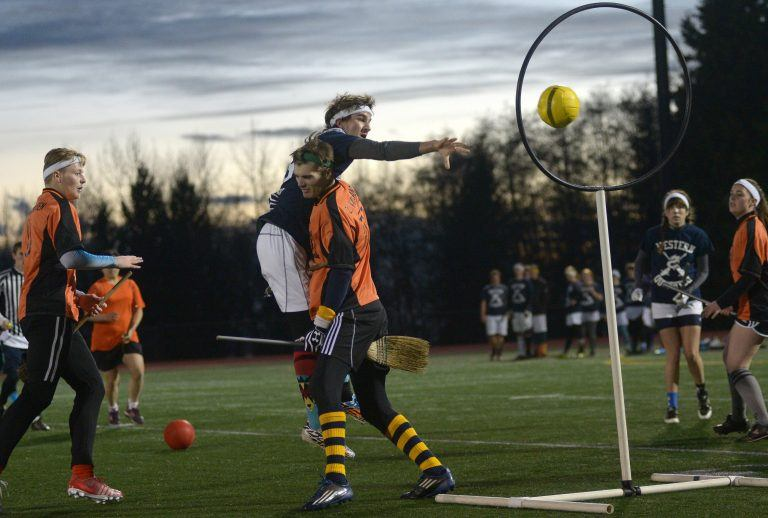 A chaser scoring points during a game of quidditch