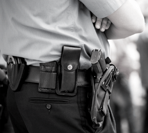 black and white photo of security officer with folded arms