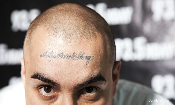 man with I slept with Shaq tattoo on his forehead