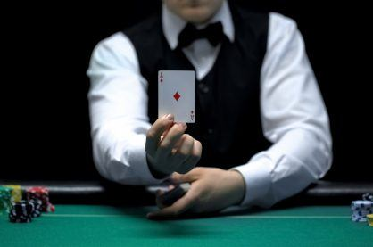 Croupier holding up a card