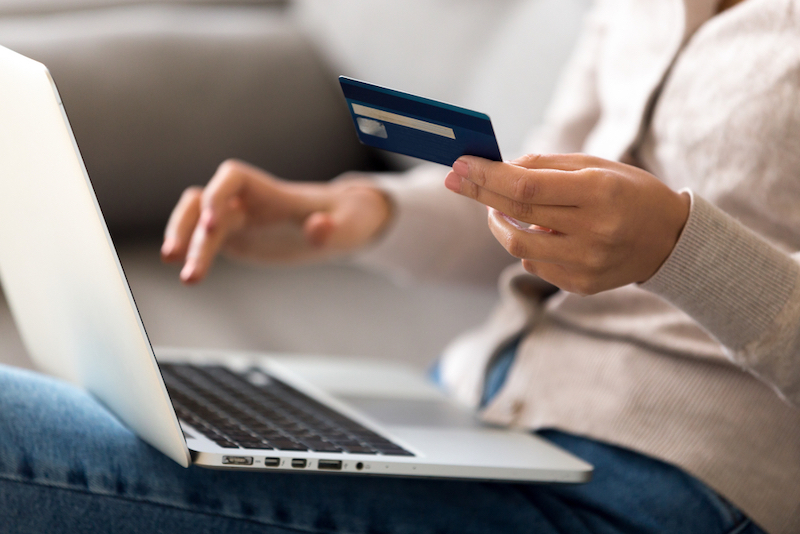 Close up woman shopping, paying by credit card
