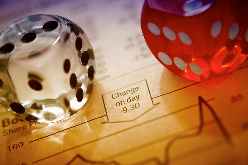 Dice on stocks and shares sheet
