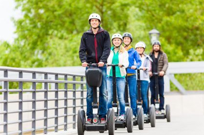 Tourist group having guided Segway city tour