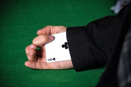 Man with ace up his sleeve.