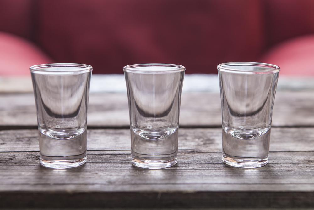three shot glasses