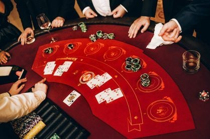 Casino dealer dealing cards and chips