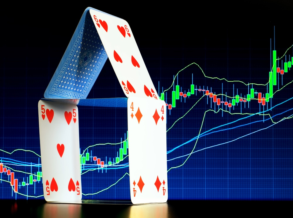 Stocks chart with playing cards in front of it