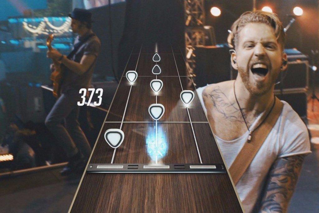 man playing VR guitar hero