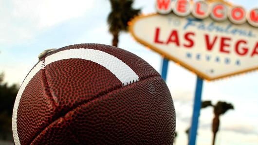 American football and vegas sign