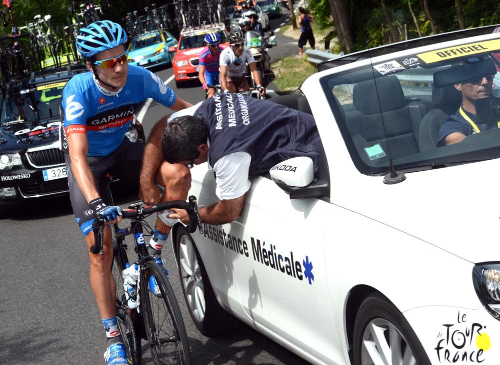 cyclists get medical help during tour de france race