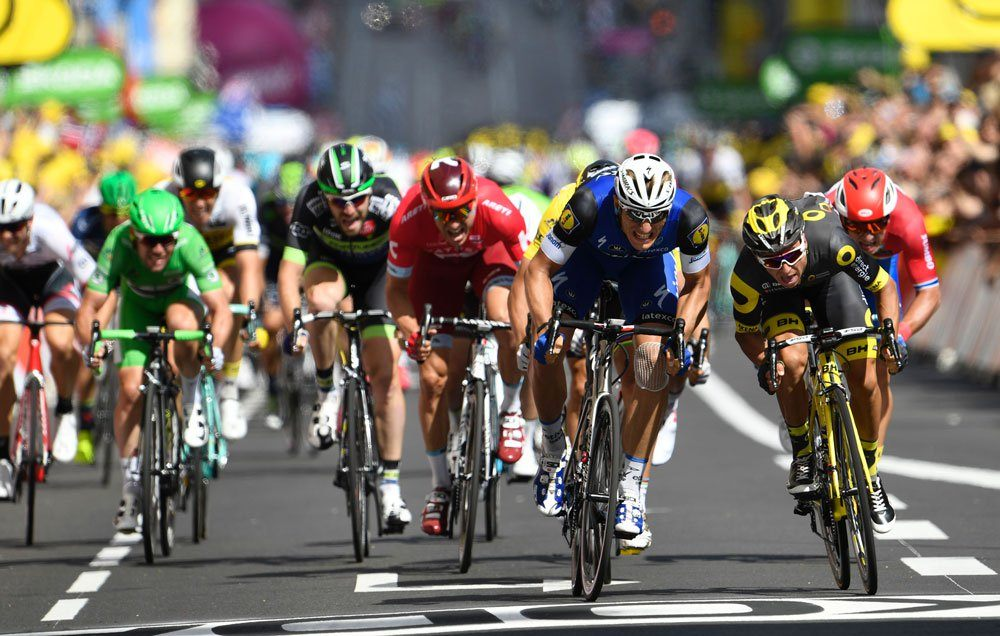 racers pedal hard in the tour de france