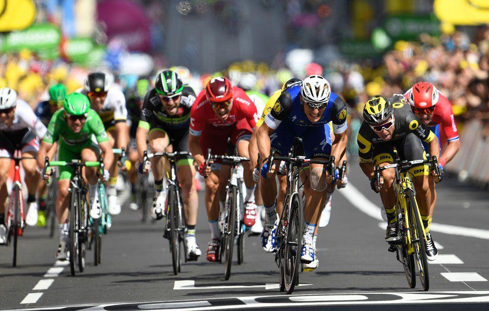 racers pedal hard in the tour de france