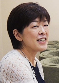 An image of Yasuko Kobayashi on a beige background