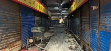 Fischmarkt in Wuhan, Geschäfte, chinesische Schriftzeichen