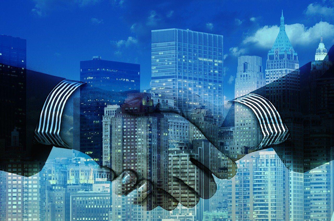 Handschlag, Wirtschaft, Fusion