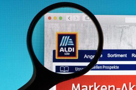 Aldi Süd logo unter Lupe