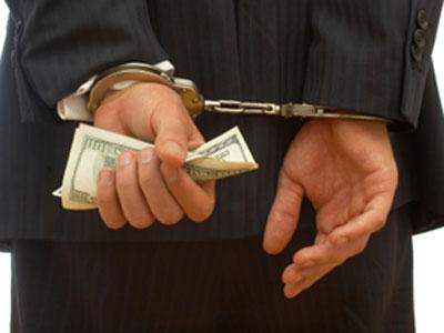 employee-fraud-handcuffs-steal-business