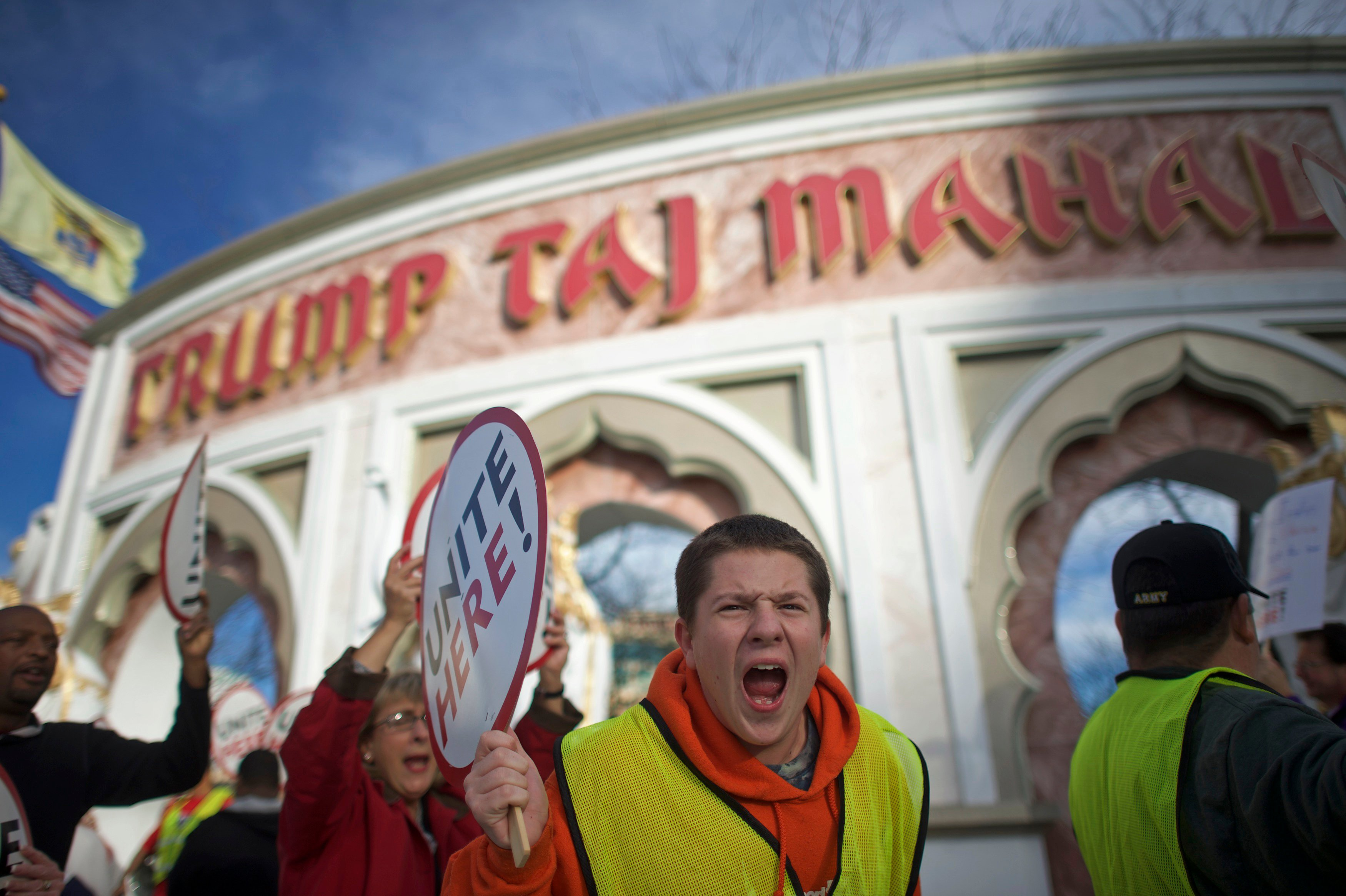 Union members from UNITE HERE Local 54 rally outside the Trump Taj Mahal Casino in Atlantic City, New Jersey
