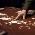 Mohegan Sun Blackjack Dealer Accused of Chip-Passing Scam
