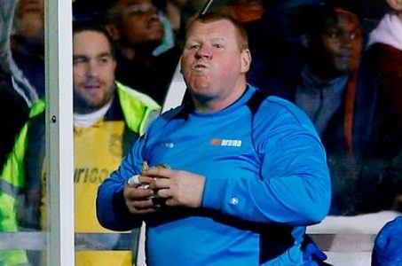 Sutton's Wayne Shaw eats pie