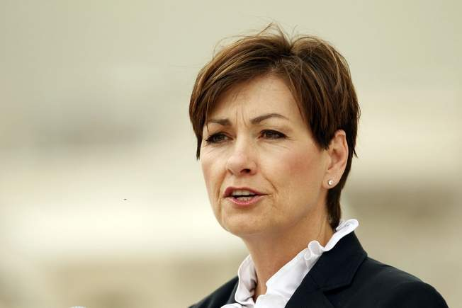 Iowa's first female governor Kim Reynolds defends use of private jet