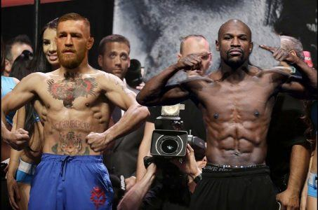McGregor and Mayweather weigh in