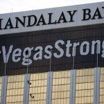 Mandalay Bay Convention Center Attendees Pass Through Hand-Held Metal Detectors at Barrett-Jackson Car Auction