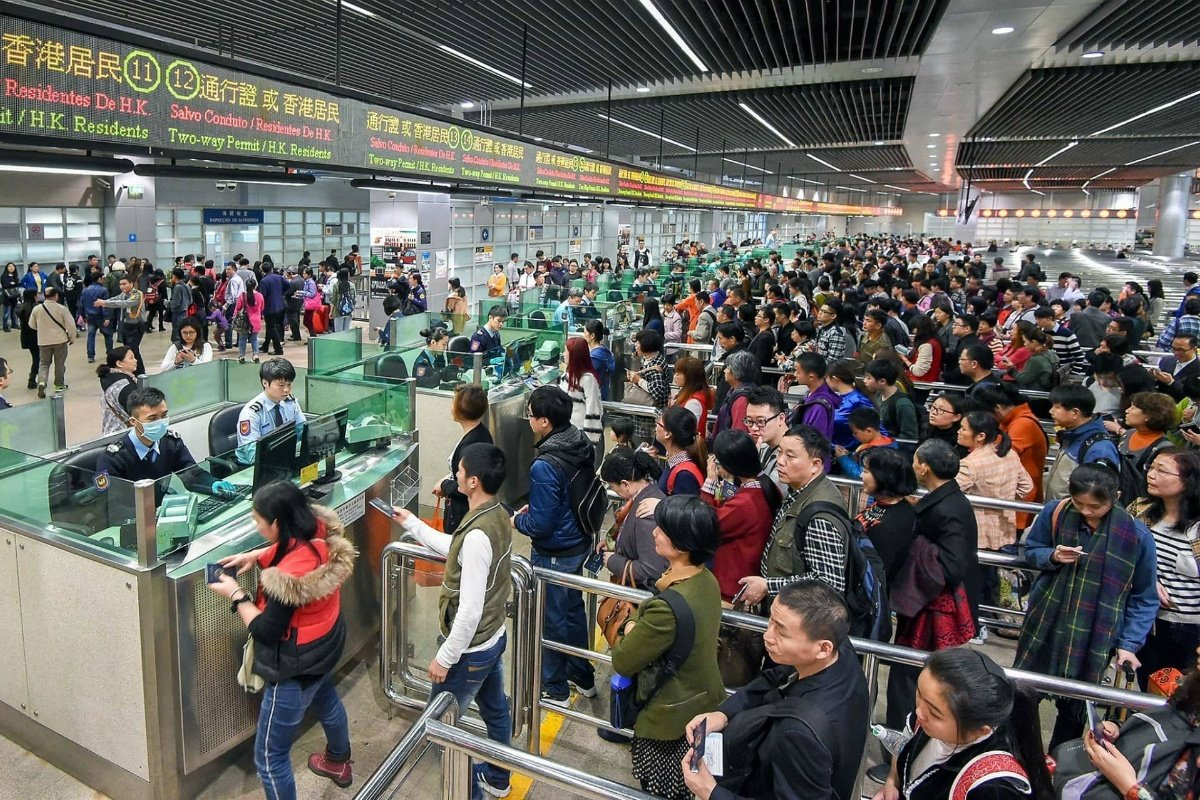 Macau visitor arrivals casino GGR