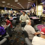 Las Vegas Poker Players, Frequently Unmasked, Gradually Return to Tables