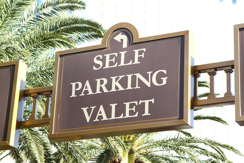 self parking valet sign