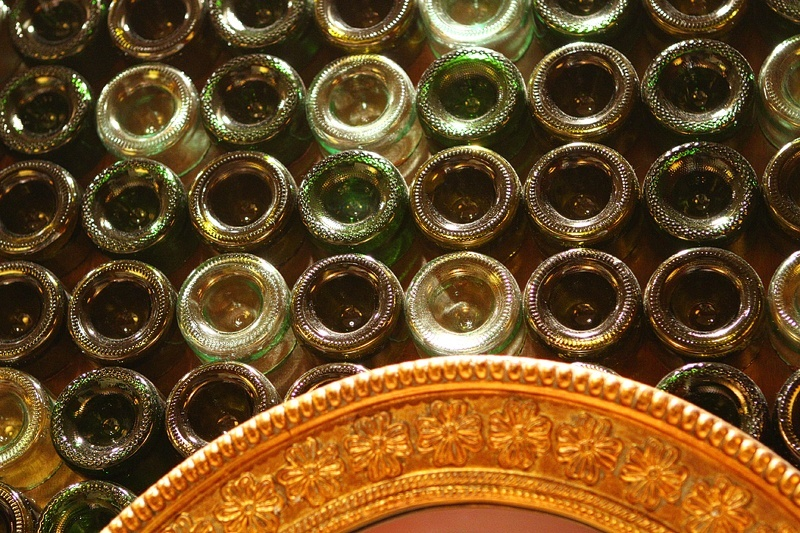 Unrelated to anything, the bathroom walls are decorated with the bottoms of wine bottles.