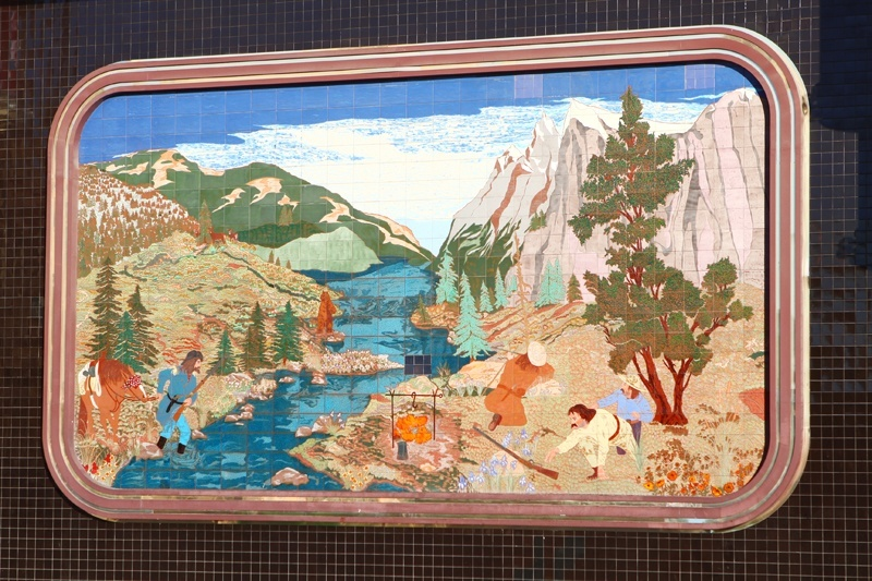 The art depicts things like mountains, a campfire, and some dim bulb trying to shoot a bear for no particular reason.