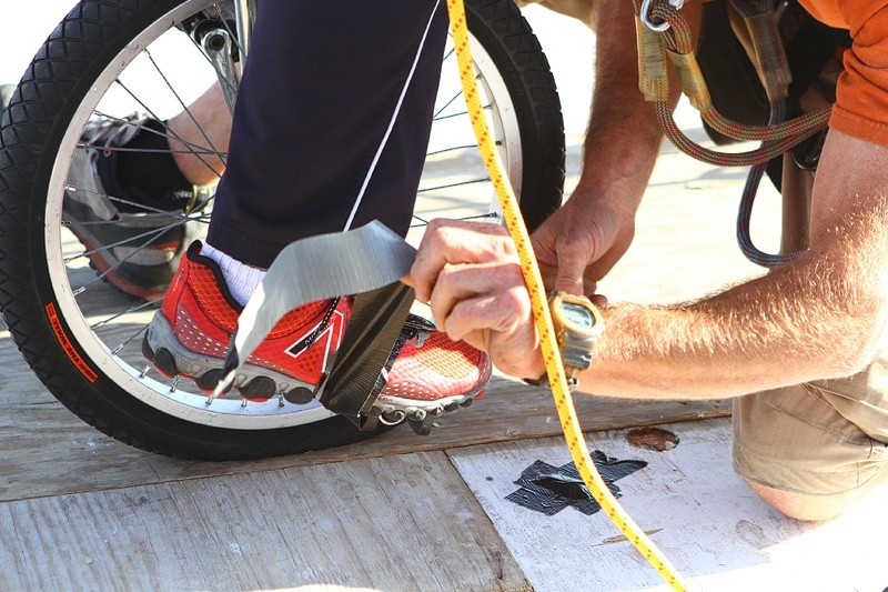 """Civillico's feet are attached to the unicycle pedals with duct tape, increasing the """"Aieee!"""" factor."""
