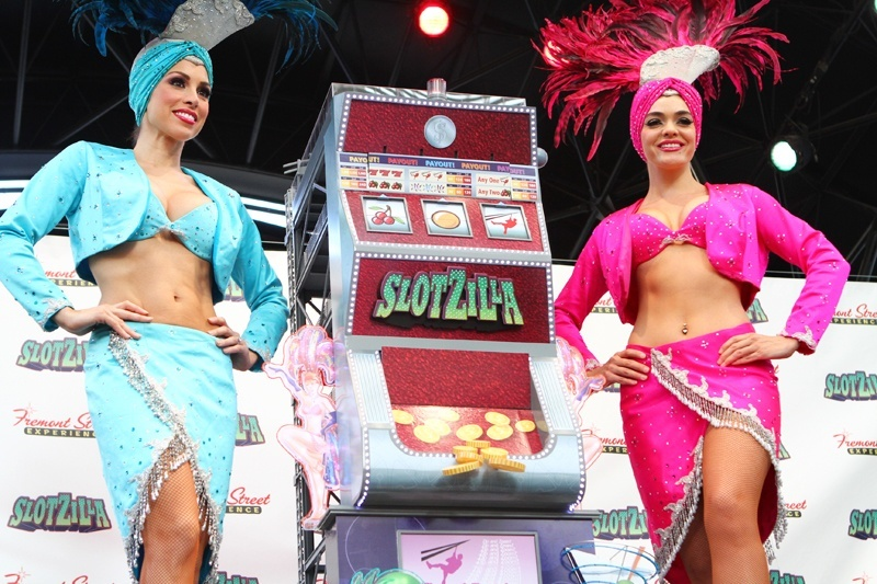 Showgirls Jen and Porsha made innumerable public appearances with Oscar Goodman. Here, they help unveil SlotZilla, downtown.